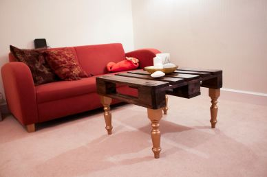Upcycled coffee table made from a wood pallet and turned pine legs for a client's first new home.